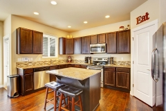 granite_kitchen_countertop_dark_brown_cabinets