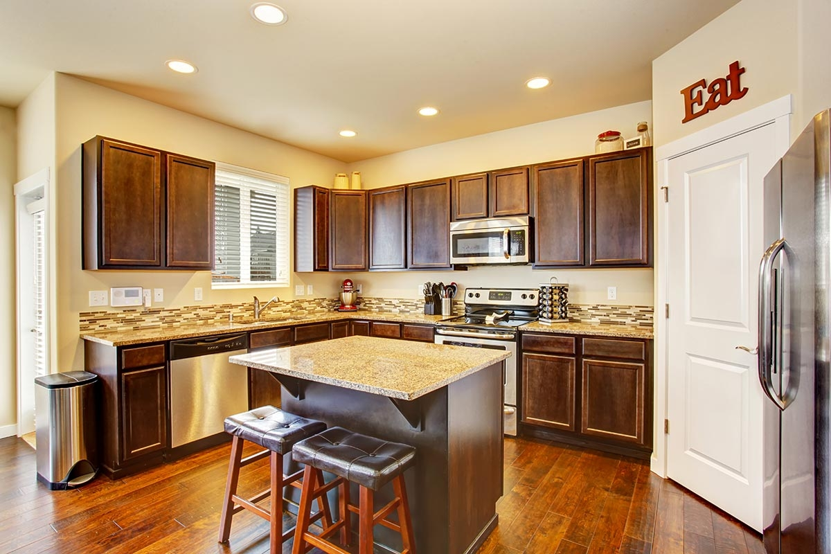 Kitchen Remodeling Gallery - Mirage Marble & Granite on Black Granite Countertops With Brown Cabinets  id=59020