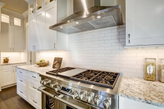 granite_countertops_white_subway_tile_backsplash