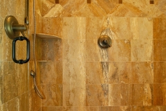 shower_remodeling_stone_tiles_warm_brown_orange
